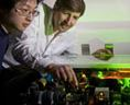 Ronald Walsworth (r) and Chih-Hao Li (l) adjust a laser frequency comb used in the search for Earth-like exoplanets. Photo credit: Harvard-Smithsonian Center for Astrophysics