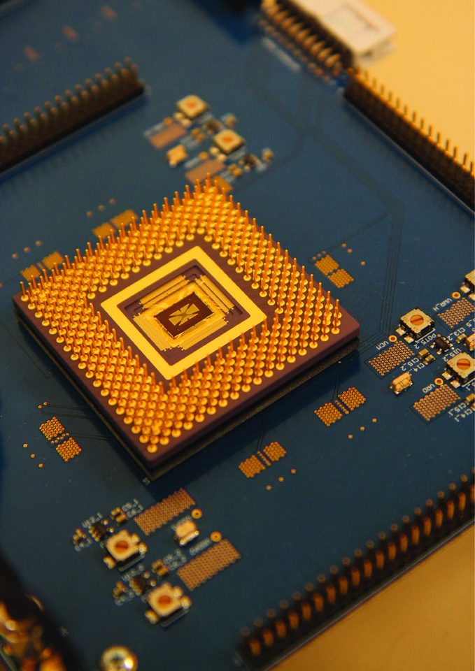 Integrating memristor arrays with CMOS circuitry to build efficient edge AI chips