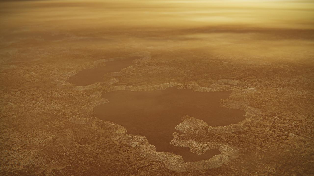 Possible explosion crater origin of small lake basins with raised rims on Titan